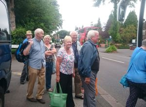 Residents, friends and families getting on the coach to Southport