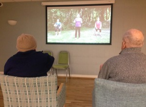 Residents following along with an exercise video
