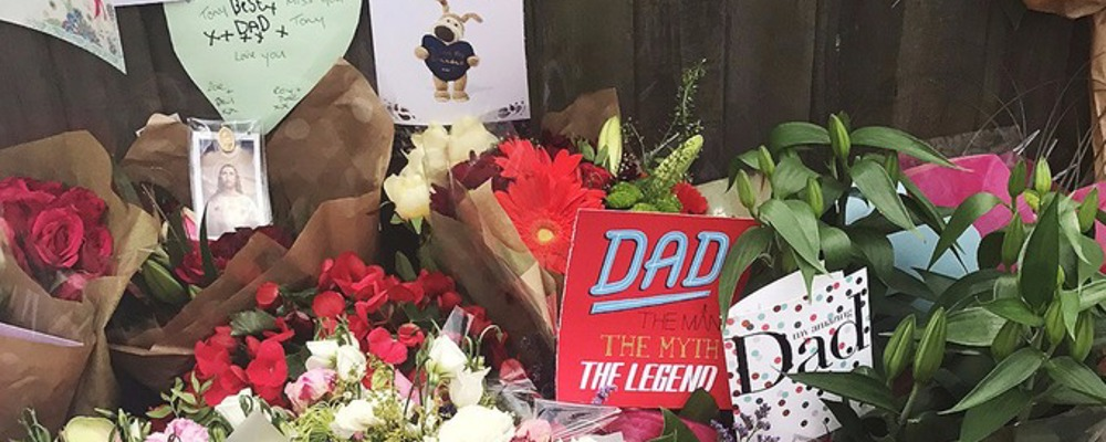 Flowers and cards in memory of Grenfell tower fire victims