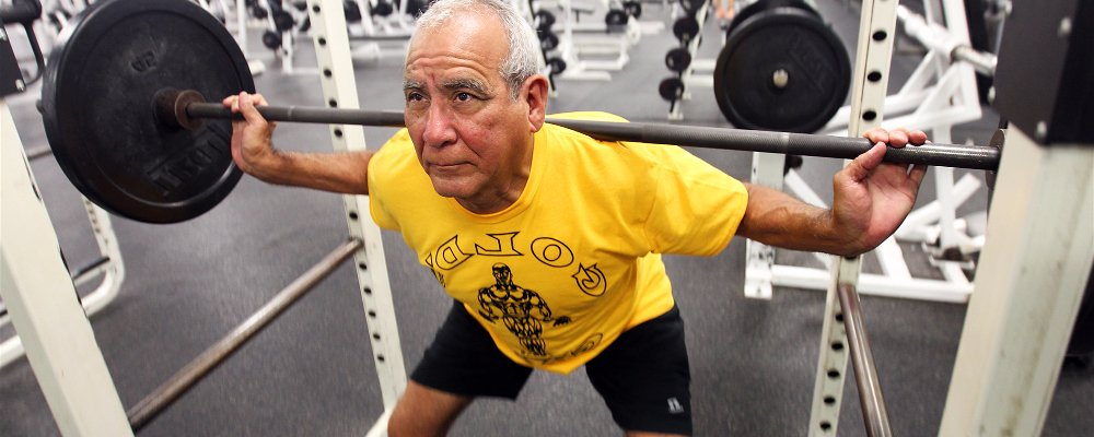 Elderly man squatting